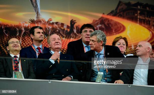 Spain's former King Juan Carlos UEFA acting president Angel Maria Villar Llona and FIFA president Gianni Infantino attend the UEFA Europa League...