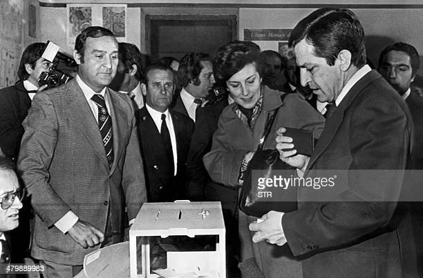 Spain's former Prime Minister Adolfo Suarez and his wife Amparo cast their vote for a national referendum to approve the Political Reform Act of 1977...