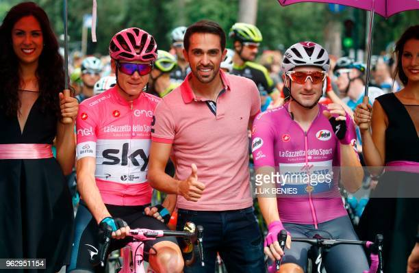 Spain's former professional cyclist Alberto Contador poses with pink jersey Britain's rider of team Sky Christopher Froome and cyclamen jersey...