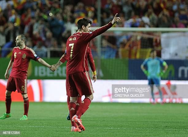 Spain's forward Alvaro Morata celebrates after scoring a goal during the EURO 2016 qualifier football match Spain vs Ukraine at the Ramon Sanchez...