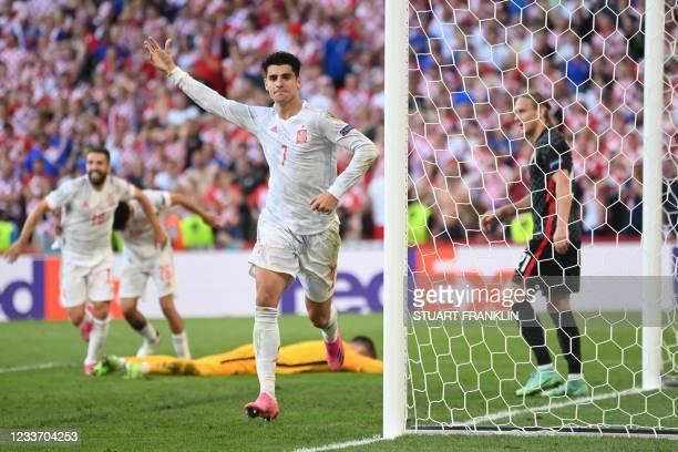 Spain's forward Alvaro Morata celebrates after scoring his team's fourth goal during the UEFA EURO 2020 round of 16 football match between Croatia...