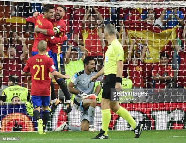 Spain's forward Alvaro Morata celebrates his goal with Spain's defender Sergio Ramos beside Italy's goalkeeper Gianluigi Buffon during the World Cup...