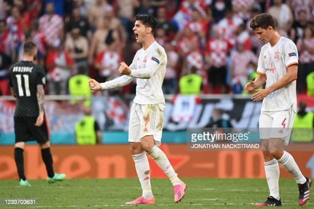 Spain's forward Alvaro Morata celebrates his team's fourth goal during the UEFA EURO 2020 round of 16 football match between Croatia and Spain at the...
