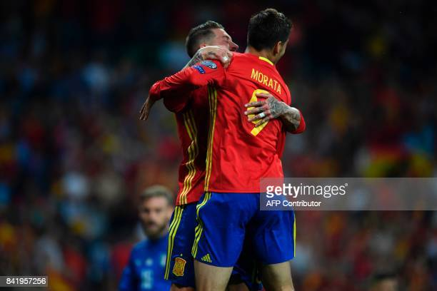 Spain's forward Alvaro Morata celebrates with Spain's defender Sergio Ramos after scoring their third goal during the World Cup 2018 qualifier...