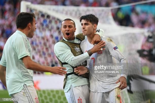 Spain's forward Alvaro Morata celebrates with Spain's midfielder Thiago Alcantara after scoring his team's fourth goal during the UEFA EURO 2020...