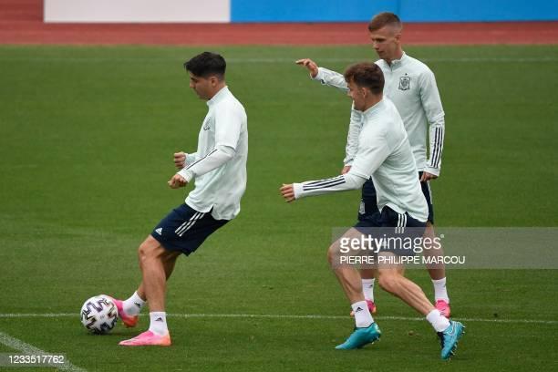 Spain's forward Alvaro Morata controls a ball past Spain's midfielder Daniel Olmo during their MD-1 training session at Las Rozas near Madrid on June...
