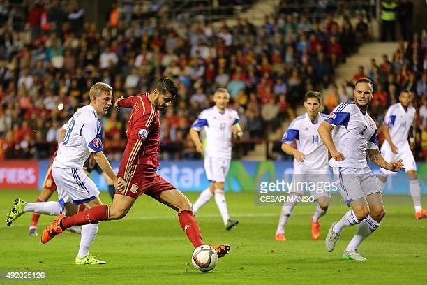 Spain's forward Alvaro Morata kicks the ball during the Euro 2016 qualifying football match Spain vs Luxembourg at Las Gaunas stadium in Logrono on...