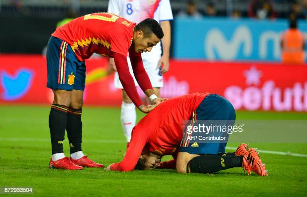 Spain's forward Alvaro Morata reacts next to Spain's midfielder Thiago after scoring a goal during the international friendly football match Spain...