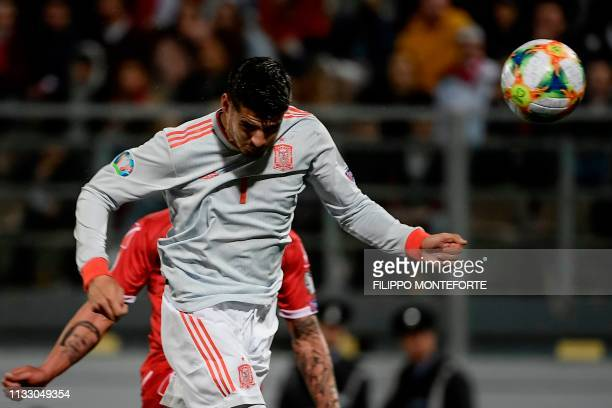 Spain's forward Alvaro Morata scores a header during the Euro 2020 Group F qualifying football match Malta vs Spain on March 26 2019 at the Ta' Qali...