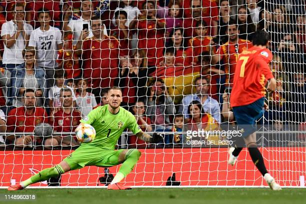 TOPSHOT Spain's forward Alvaro Morata shoots a penalty kick to score Spain's second goal during the UEFA Euro 2020 group F qualifying football match...