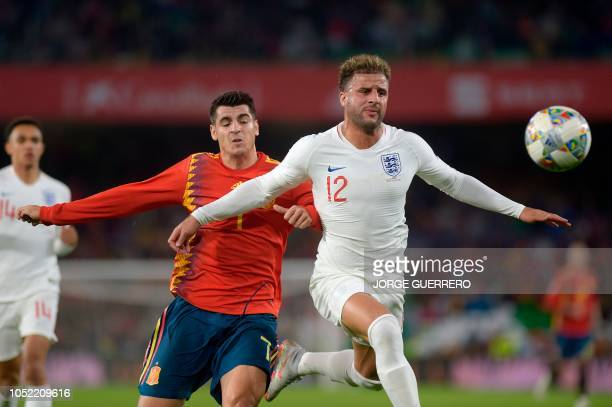 Spain's forward Alvaro Morata vies with England's defender Kyle Walker during the UEFA Nations League football match between Spain and England on...