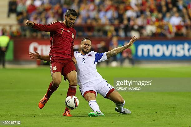 Spain's forward Alvaro Morata vies with Luxembourg's defender Maxime Chanot during the Euro 2016 qualifying football match Spain vs Luxembourg at Las...