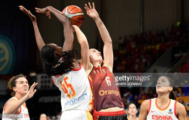 Spain's forward Astou Ndour cies with Belgium's forward Antonia Delaere during the FIBA 2018 Women's Basketball World Cup third place final match...