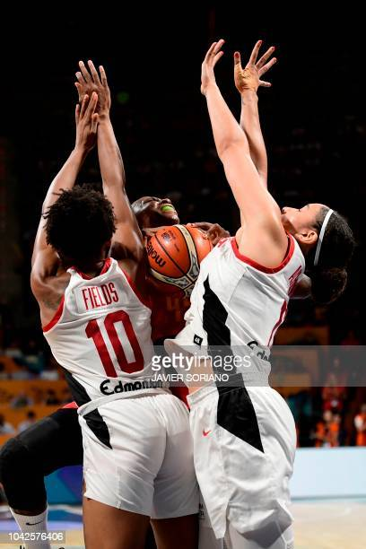 Spain's forward Astou Ndour vies with Canada's guard Nirra Fields and Canada's forward Natalie Achonwa during the FIBA 2018 Women's Basketball World...