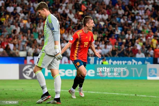 Spain's forward Dani Olmo celebrates after scoring his team's second goal past Germany's goalkeeper Alexander Nuebel during the final match of the...