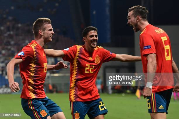 Spain's forward Dani Olmo celebrates scoring with Spain's midfielder Pablo Fornals and Spain's midfielder Fabian Ruiz during the semifinal match of...