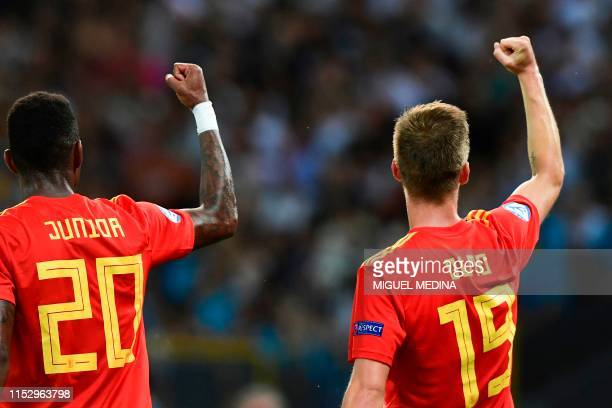 Spain's forward Dani Olmo celebrates with Spain's defender Junior Firpo after scoring his team's second goal during the final match of the UEFA U21...