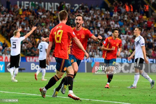 Spain's forward Dani Olmo celebrates with Spain's midfielder Fabian Ruiz after scoring his team's second goal during the final match of the UEFA U21...