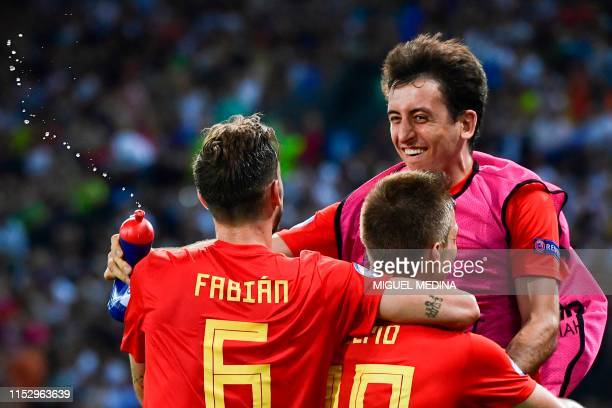 Spain's forward Dani Olmo celebrates with Spain's midfielder Fabian Ruiz and Spain's midfielder Mikel Oyarzabal after scoring his team's second goal...