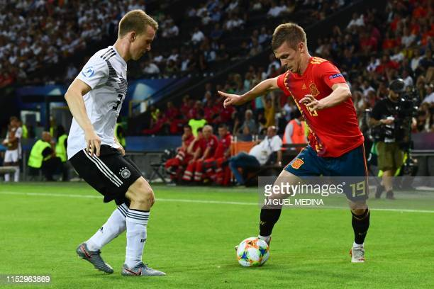 Spain's forward Dani Olmo challenges Germany's defender Lukas Klostermann during the final match of the UEFA U21 European Football Championships...