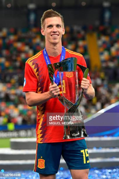 Spain's forward Dani Olmo holds the winners trophy after Spain won the final match of the UEFA U21 European Football Championships against Germany on...