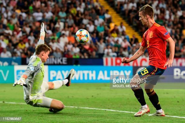 Spain's forward Dani Olmo scores his team's second goal past Germany's goalkeeper Alexander Nuebel during the final match of the UEFA U21 European...