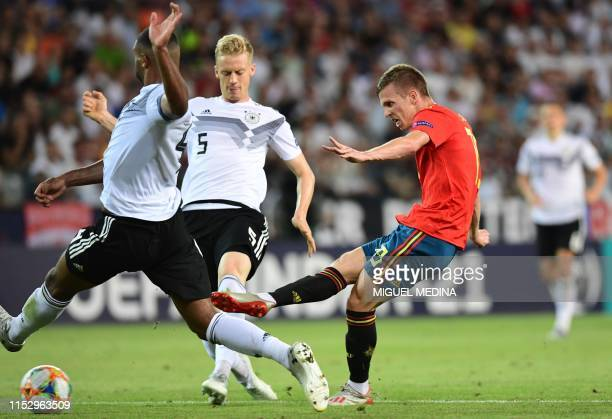 Spain's forward Dani Olmo shoots on goal during the final match of the UEFA U21 European Football Championships between Spain and Germany on June 30...