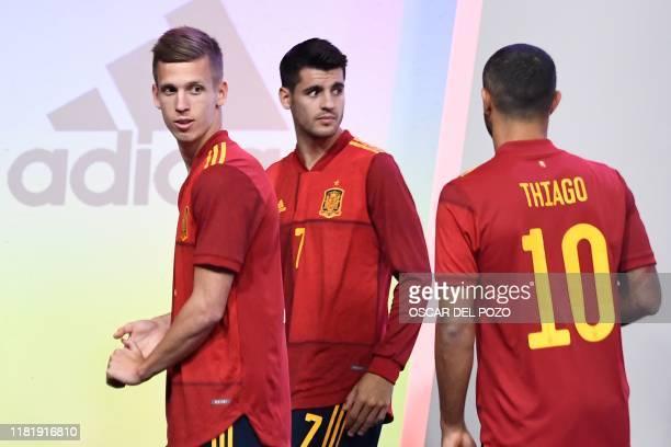 Spain's forward Dani Olmo, Spain's forward Alvaro Morata and Spain's midfielder Thiago Alcantara attend the presentation of Spain's new jersey for...