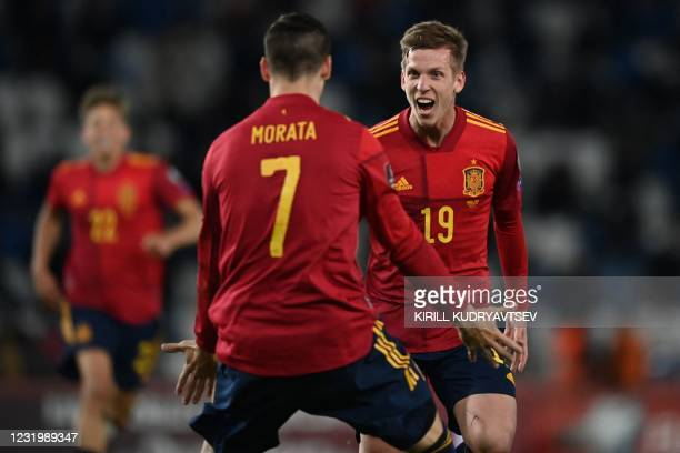 Spain's forward Daniel Olmo celebrates with teammates after scoring the team's second goal during the FIFA World Cup Qatar 2022 qualification...