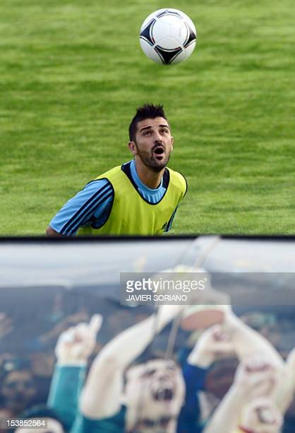 Spain's forward David Villa eyes the ball during a training session at Las Rozas sport city near Madrid on October 10 ahead of their World Cup 2014...