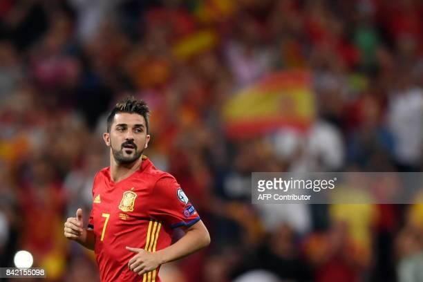 Spain's forward David Villa runs during the World Cup 2018 qualifier football match Spain vs Italy at the Santiago Bernabeu stadium in Madrid on...