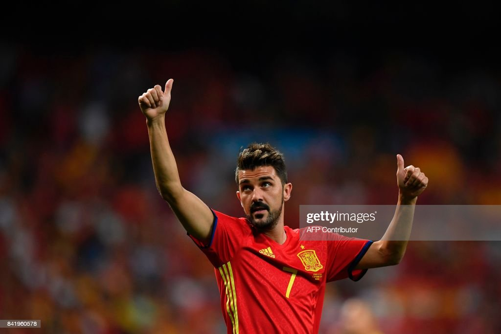 Spain's forward David Villa waves as he celebrates their victory at the end of the World Cup 2018 qualifier football match Spain vs Italy at the Santiago Bernabeu stadium in Madrid on September 2, 2017. Spain won 3-0. /