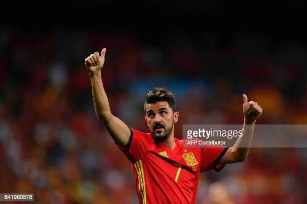 Spain's forward David Villa waves as he celebrates their victory at the end of the World Cup 2018 qualifier football match Spain vs Italy at the...