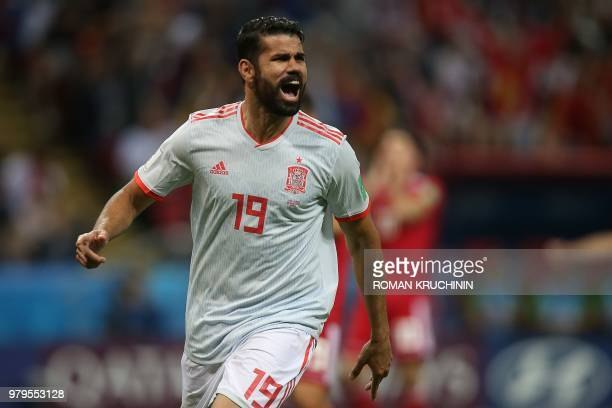 TOPSHOT Spain's forward Diego Costa celebrates his goal during the Russia 2018 World Cup Group B football match between Iran and Spain at the Kazan...