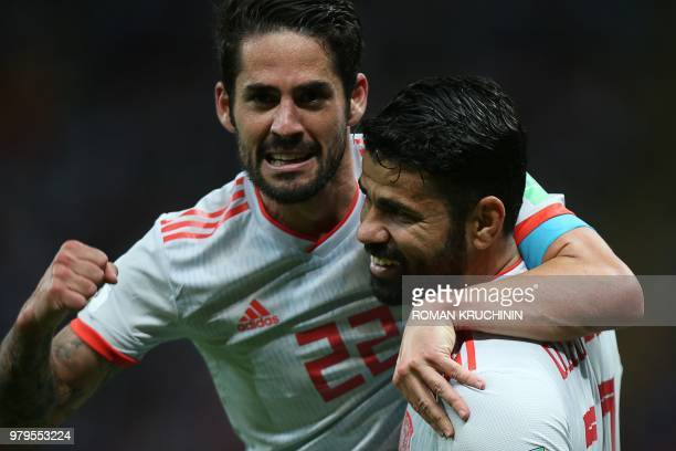 Spain's forward Diego Costa celebrates his goal with midfielder Isco during the Russia 2018 World Cup Group B football match between Iran and Spain...
