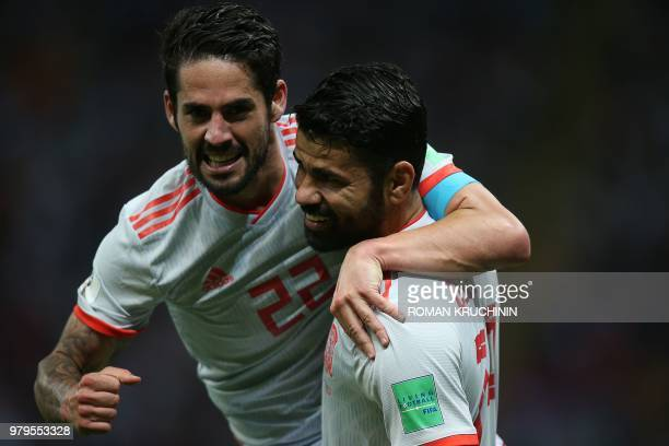 TOPSHOT Spain's forward Diego Costa celebrates his goal with midfielder Isco during the Russia 2018 World Cup Group B football match between Iran and...