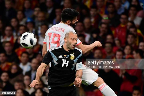 Spain's forward Diego Costa heads the ball with Argentina's defender Javier Mascherano during a friendly football match between Spain and Argentina...