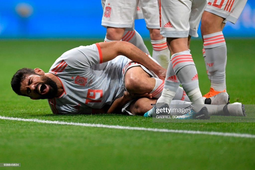 Spain's forward Diego Costa reacts in pain after scoring a goal during a friendly football match between Spain and Argentina at the Wanda Metropolitano Stadium in Madrid on March 27, 2018. /