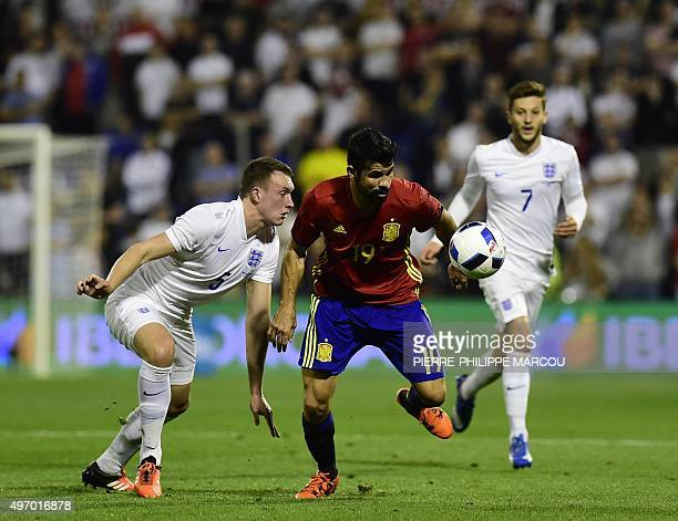 Spain's forward Diego Costa vies with England's defender Phil Jones during the friendly football match Spain vs England at the Jose Rico Perez...
