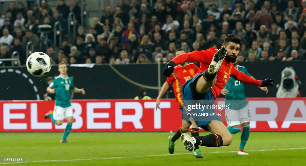 Spain's forward Diego da Silva Costa plays the ball during the international friendly football match of Germany vs Spain in Duesseldorf, western Germany, on March 23, 2018, in preparation of the 2018 Fifa World Cup. / AFP PHOTO / Odd ANDERSEN