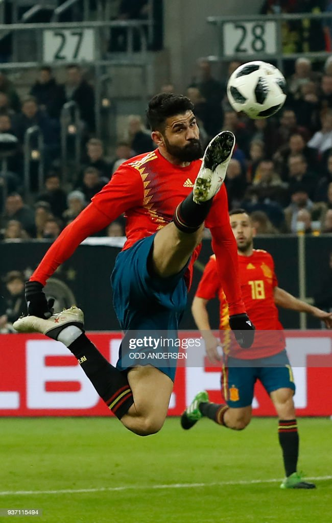 Spain's forward Diego da Silva Costa plays the ball during the international friendly football match of Germany vs Spain in Duesseldorf, western Germany, on March 23, 2018, in preparation of the 2018 Fifa World Cup. / AFP PHOTO / Odd ANDERSEN / The erroneous mention[s] appearing in the metadata of this photo by Odd ANDERSEN has been modified in AFP systems in the following manner: [Spain's forward Diego da Silva Costa] instead of [Spain's midfielder Isco]. Please immediately remove the erroneous mention[s] from all your online services and delete it (them) from your servers. If you have been authorized by AFP to distribute it (them) to third parties, please ensure that the same actions are carried out by them. Failure to promptly comply with these instructions will entail liability on your part for any continued or post notification usage. Therefore we thank you very much for all your attention and prompt action. We are sorry for the inconvenience this notification may cause and remain at your disposal for any further information you may require.