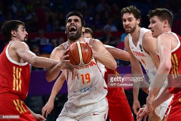 Spain's forward Fernando San Emeterio vies with Russia's guard Alexey Shved and Semen Antonov during the FIBA Euro basket 2017 men's 3rd game match...
