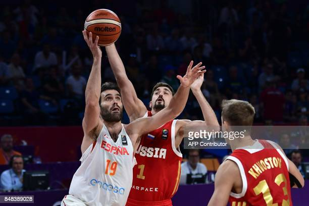 Spain's forward Fernando San Emeterio vies with Russia's guard Alexey Shved during the FIBA Euro basket 2017 men's 3rd game match between Spain and...