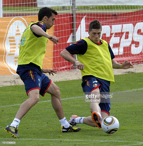 Spain's forward Fernando Torres vies with Spain's defender Alvaro Arbeloa during a training session of the Spanish football team on May 27 at the...