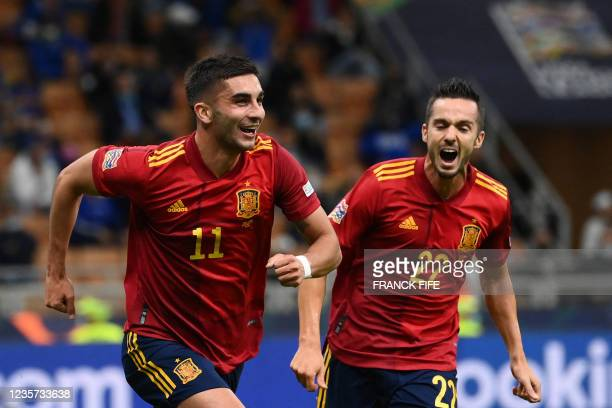 Spain's forward Ferran Torres celebrates with teammates after scoring a goal during the UEFA Nations League semifinal football match between Italy...