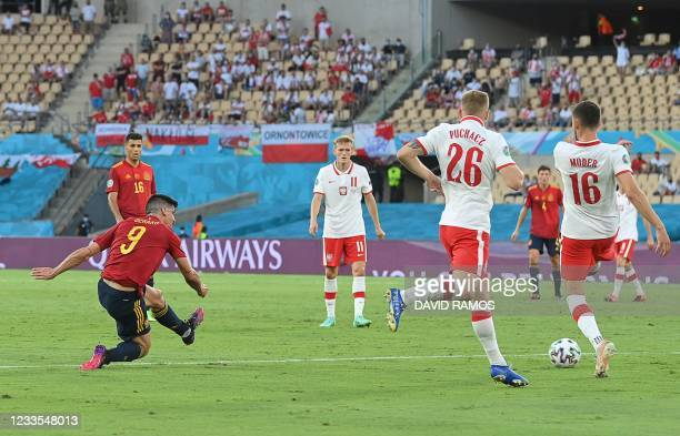 Spain's forward Gerard attempts a shot, which leads to a goal, during the UEFA EURO 2020 Group E football match between Spain and Poland at La...