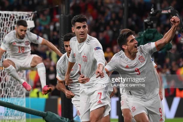 Spain's forward Gerard congratulates Spain's forward Alvaro Morata after scoring their team's first goal during the UEFA EURO 2020 semi-final...
