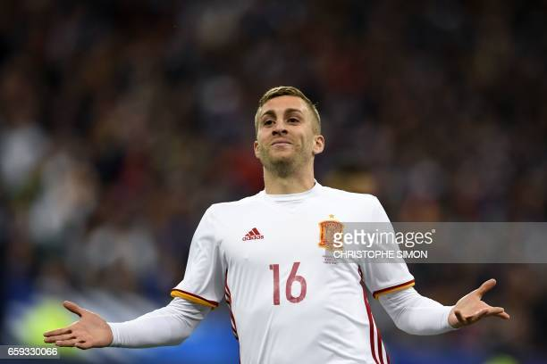 Spain's forward Gerard Deulofeu celebrates scoring a goal during the friendly football match France vs Spain on March 28 2017 at the Stade de France...