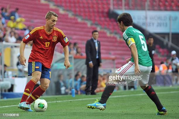 Spain's forward Gerard Deulofeu vies with Mexico's defender Bernando Hernandez during a round 16 stage football match between Spain and Mexico at the...