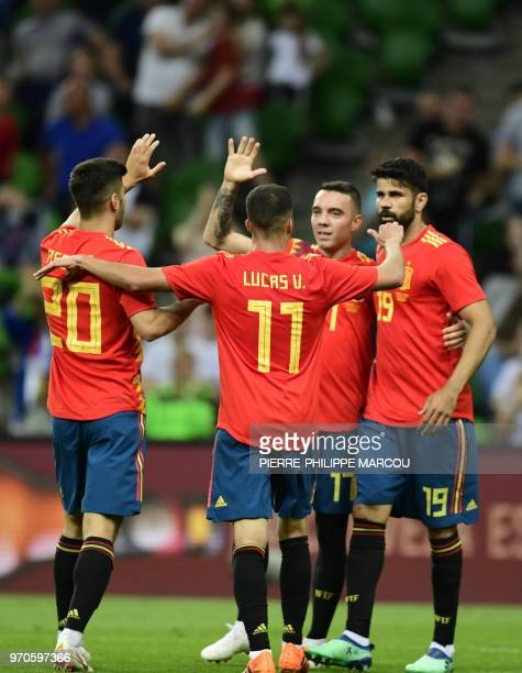 Spain's forward Iago Aspas celebrates after scoring a goal against with Spain's midfielder Marco Asensio Spain's midfielder Lucas Vazquez and Spain's...